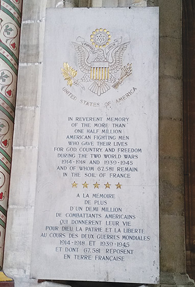 A stone slab with text memorializing an American Soldier