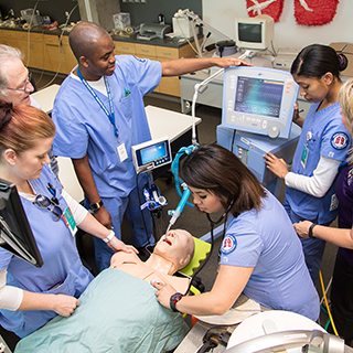 Respiratory care students practice on a mannequin