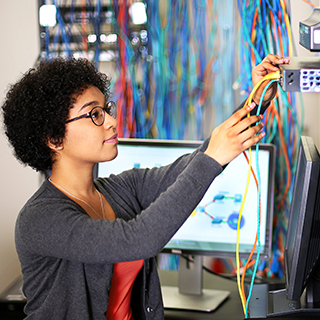 Woman working with network cables
