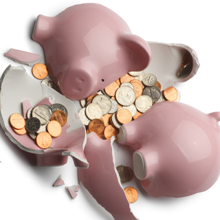 Broken piggy bank with money spilling out