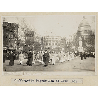vintage photo fo a suffragette parade, dated March 3, 1913